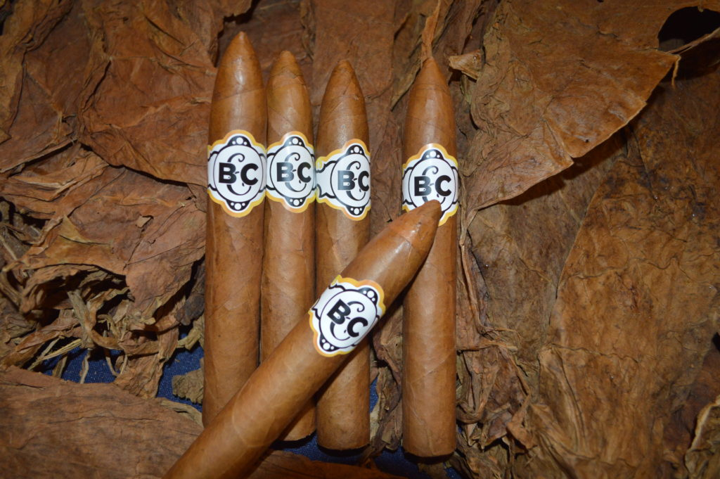 Cuban style hand rolled cigars with custom logo.